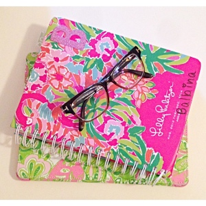 Here I keep my Lilly Pulitzer agenda and my iPad that has a Lilly case as well. I also keep my glasses here whenever I don't use them.